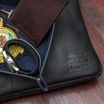 Eurofighter typhoon men's tray holding watch and brown 29 squadron cardholder sitting on typhoon display laptop case