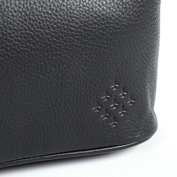 close up of diamond 9 logo on black washbag