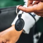 lady holding asali diamond 9 key ring in navy