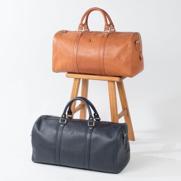 italian tan weekender and embossed navy weekender holdall bags