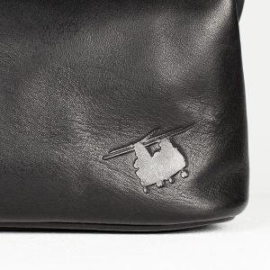 chinook silhouette on black wash bag